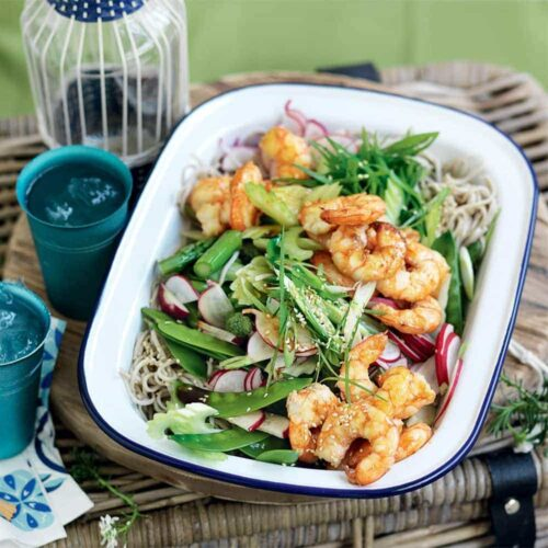 Grilled prawns with snow peas, asparagus and noodle salad