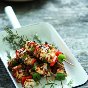 Grilled chicken on rosemary skewers