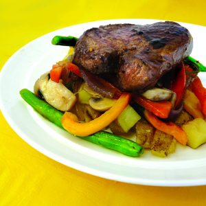 Grilled fillet with spud roasties and sautéed veges