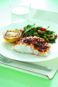 Grilled fish and lemon with olive salad
