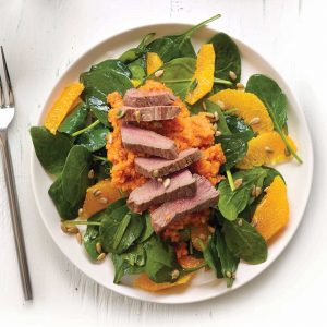 Grilled lamb with carrot miso purée and orange salad