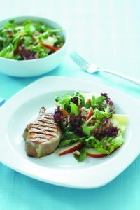 Grilled pork with pear and cheddar salad