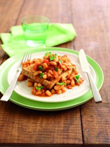 Homemade baked beans and ham on toast
