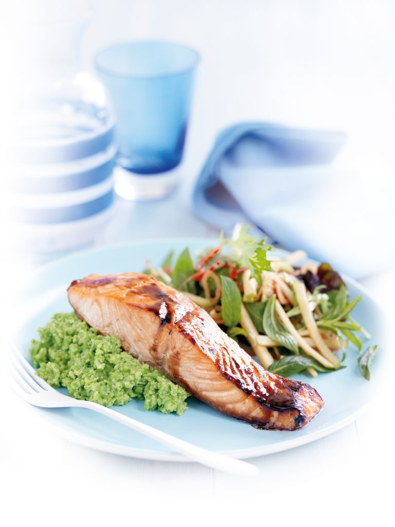 Honey-spiced salmon with wasabi pea mash and apple salad
