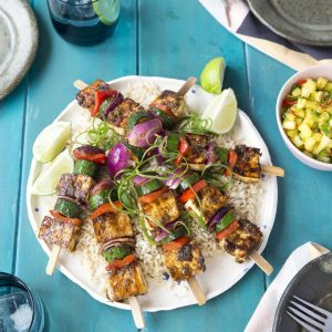 Jerk spiced tofu and vege kebabs on brown rice