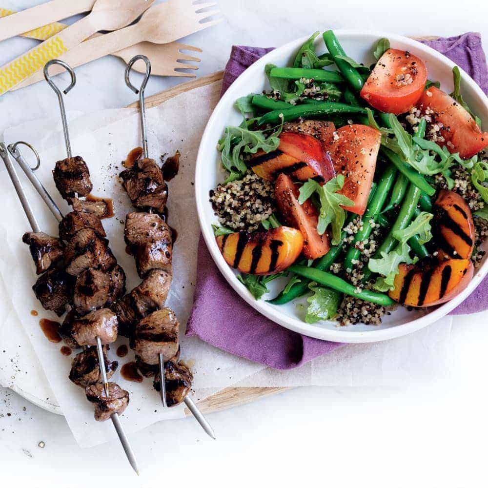 Lamb skewers with peach and quinoa salad
