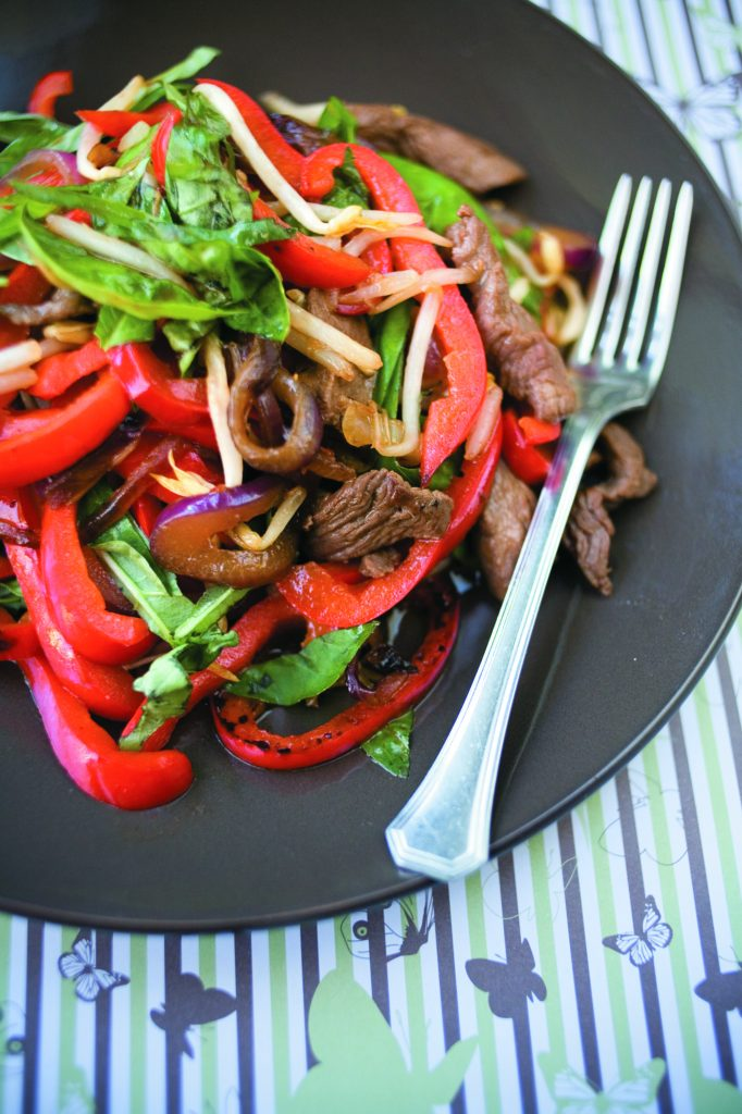 Marinated steak with bean sprouts and basil