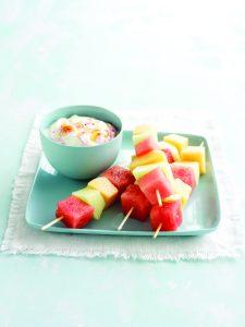 Melon skewers with berry swirl yoghurt