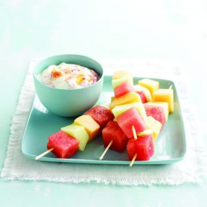 Melon skewers with berry swirl yoghurt