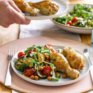 Mustard chicken with roasted chickpeas, tomatoes and garlicky greens
