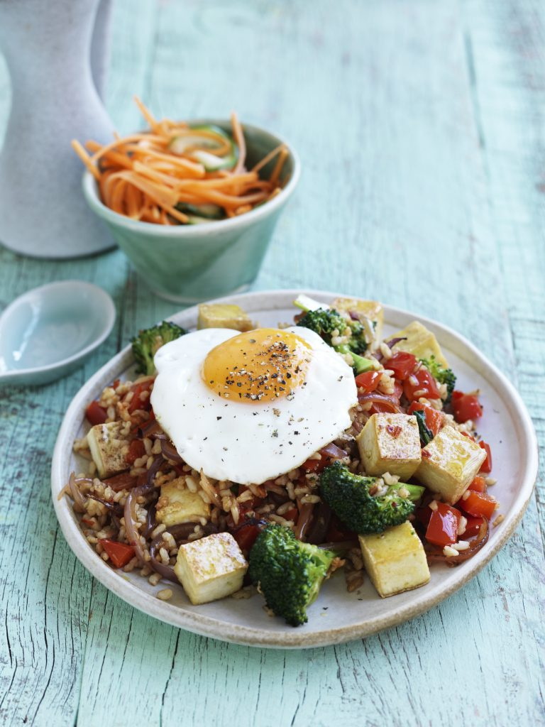 Nasi goreng with fried egg, pickled cucumber and carrot