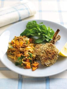 Oat-crusted lamb cutlets with spiced lentils
