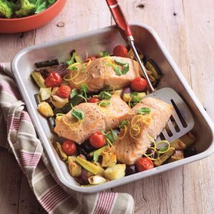 Oven-roasted salmon with oregano, lemon and tender veges