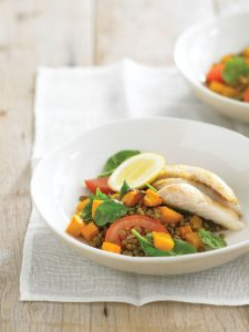 Pan-fried fish with lentil and spinach salad