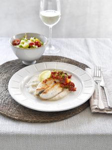 Pan-fried fish with cauliflower puree and citrus caper salsa