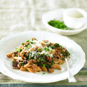 Penne with lamb, olives and spinach