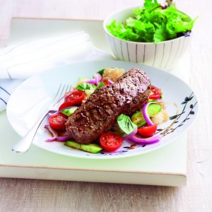 Pepper steak with bread salad