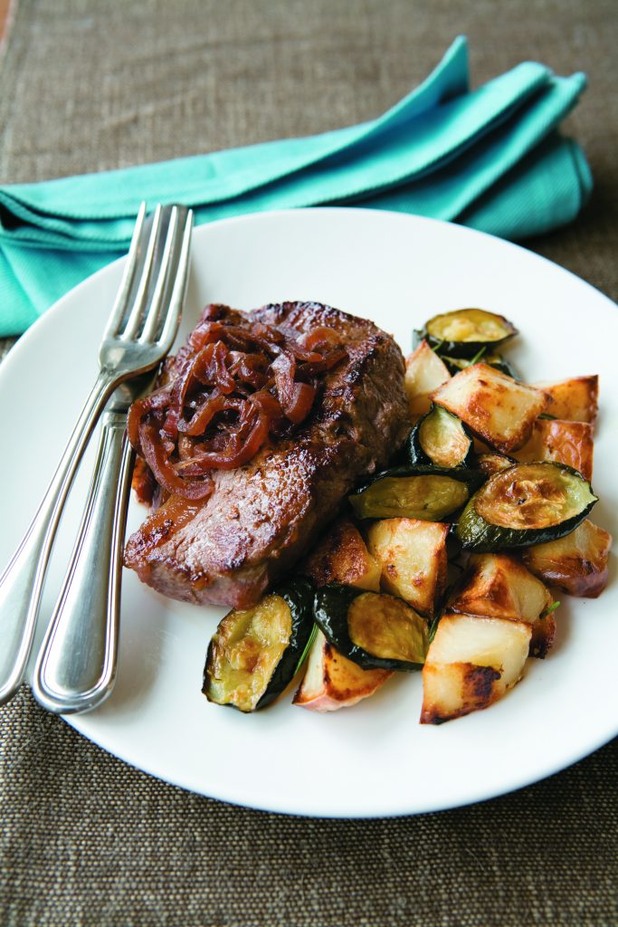 Peppered steaks with caramelised onions