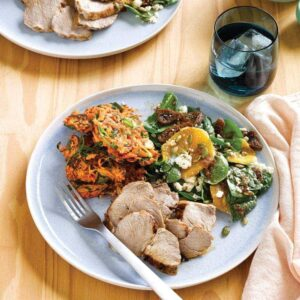 Pork with kumara cakes and fig, orange and silver beet salad