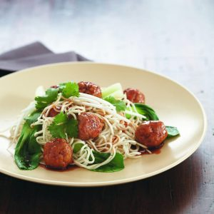 Pork meatballs with egg noodles and Asian greens