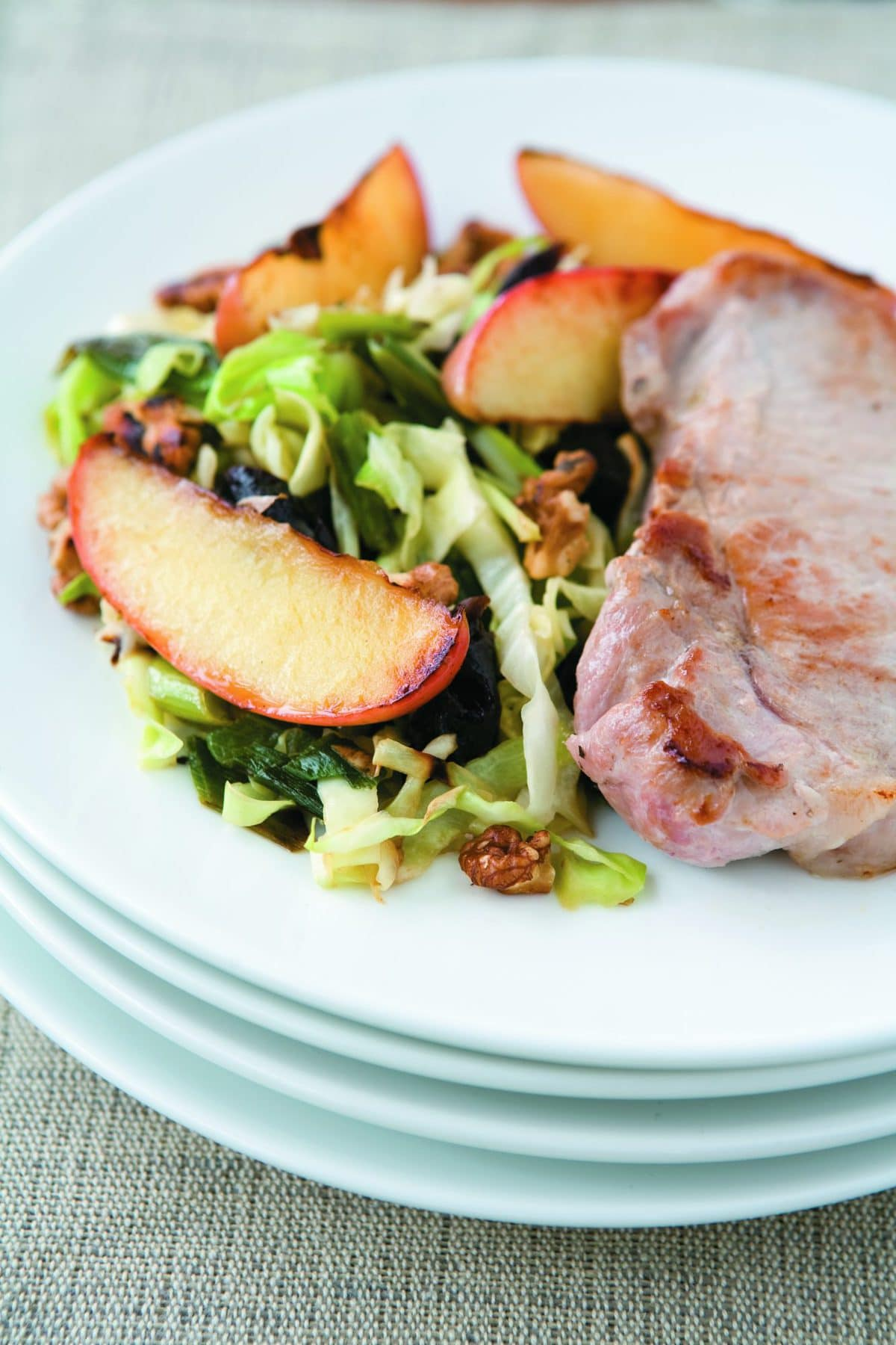 Pork steaks with apple and walnut slaw