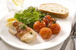 Prosciutto-wrapped fish with roasted vine tomatoes