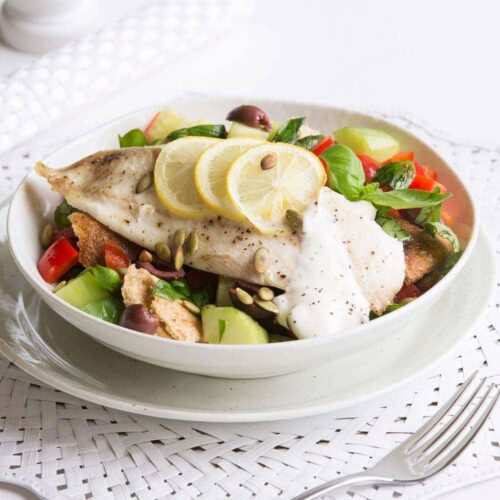 Quick lemon-roasted fish with tomato and olive salad
