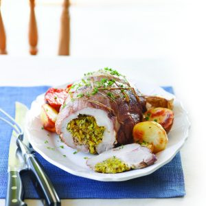Roast pork with herb and apricot stuffing