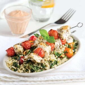 Rosemary chicken sticks with brown rice salad and sun-dried tomato dip