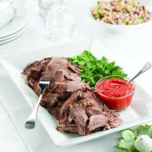Rosemary-marinated lamb leg with roasted pepper relish