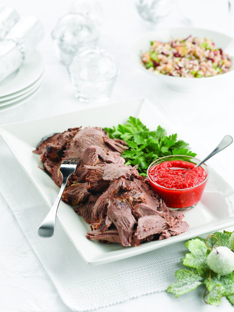 Rosemary-marinated lamb leg with roasted pepper relish
