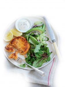 Salmon and kumara cakes with cucumber and avocado salad