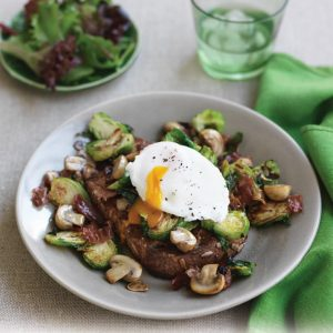 Sautéed sprouts and mushrooms with poached egg