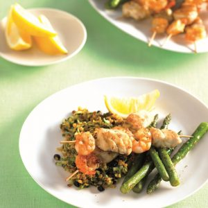 Seafood skewers with lentil salad