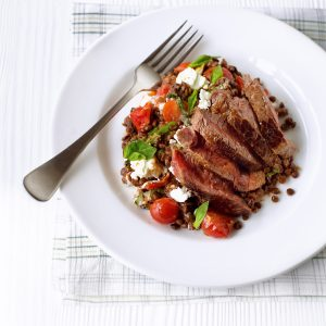 Seared steak with sun-dried tomato lentils
