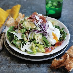 Shaved Brussels sprout salad with prosciutto and poached eggs