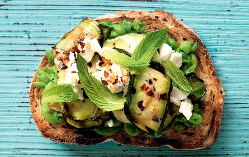 Smashed pea, courgette, feta and mint toast topper