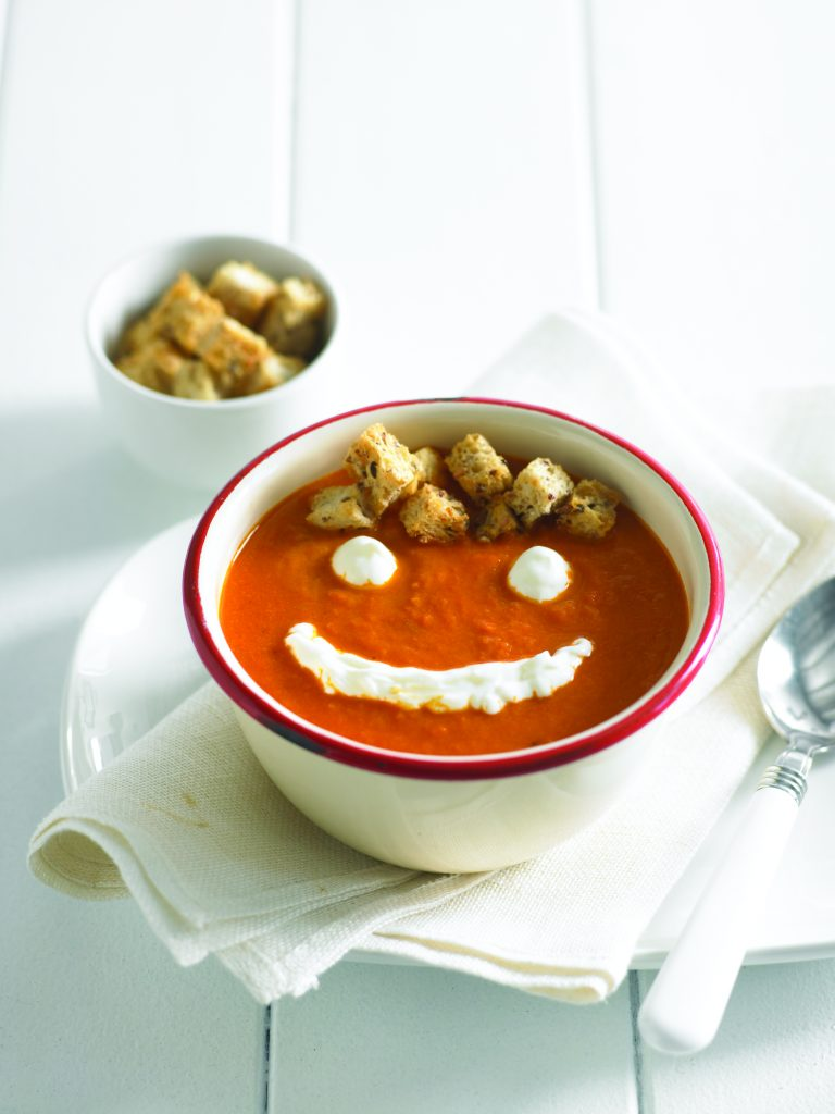 Smiley face tomato soup