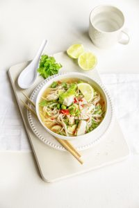 Soba noodle soup with fish and Asian greens