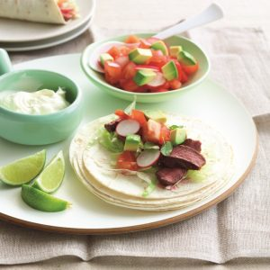 Soft beef tacos with radish and tomato salsa