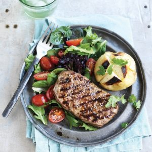 Spice-rubbed steak with baked potatoes