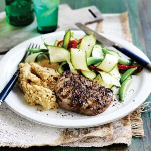 Spiced lamb with chickpea mash and courgette salad