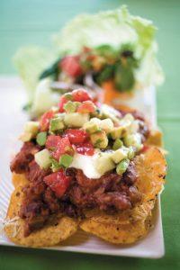 Spicy bean nachos with avocado salsa and salad