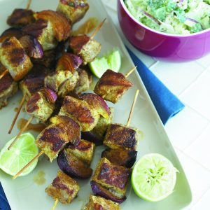 Spicy pork skewers with apple coleslaw