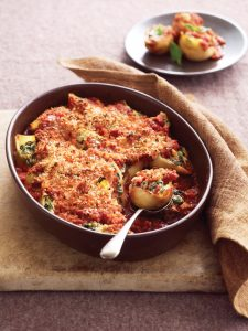 Spinach and ricotta shells with tomato and breadcrumbs