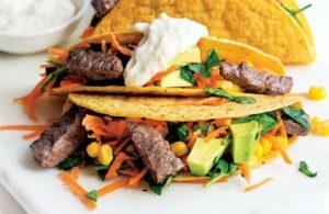 Steak tacos with avocado corn salsa and horseradish drizzle