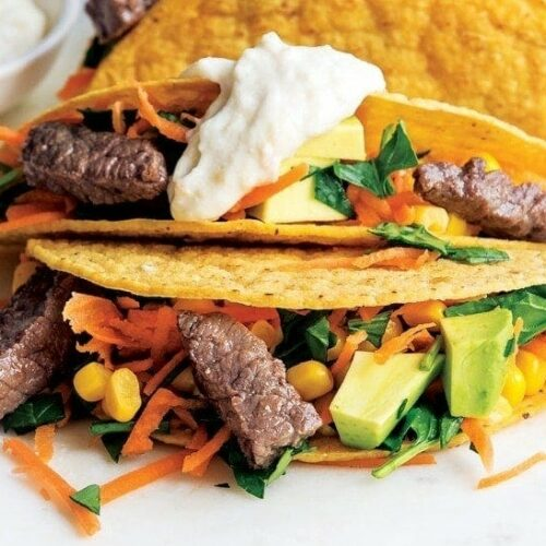Steak tacos with avocado corn salsa and horseradish drizzle