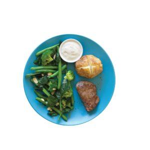 Steak with horseradish cream, baked potato and greens