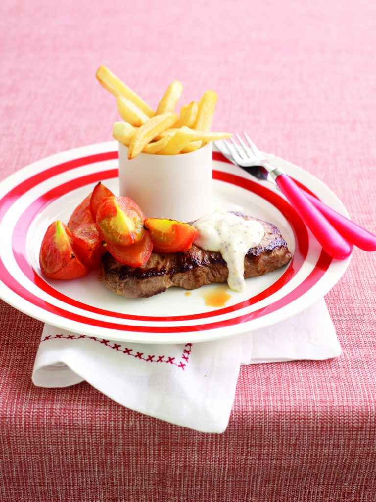 Steak with creamy mustard sauce and oven chips