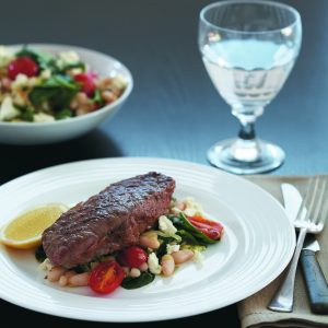 Steak with warm bean and spinach salad